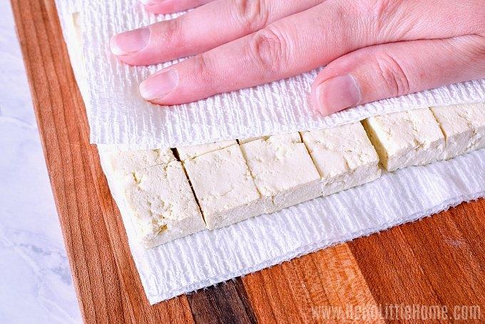 Pressing tofu for Buffalo Tofu Bites.