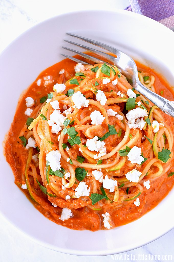 A bowl of Zoodles with Romesco and Feta.