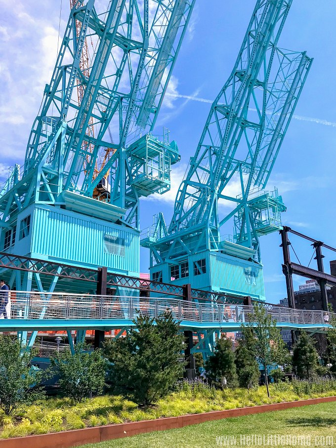 Turquoise painted Gantry Cranes in Domino Park, a relic from the Domino Sugar Factory.