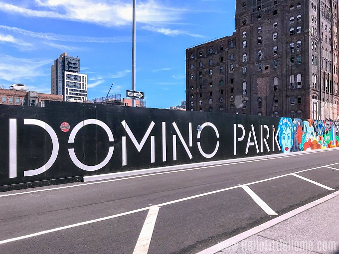 Colorful sign and murals in Domino Park Brooklyn