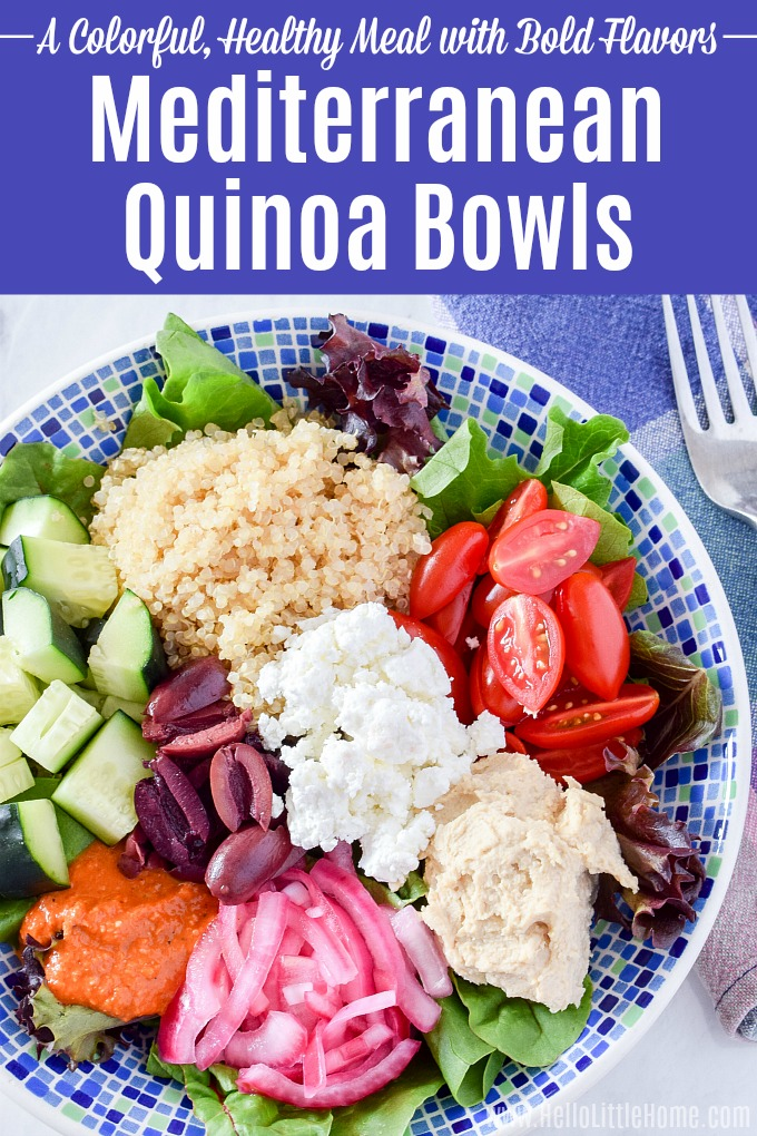 A Mediterranean Quinoa Bowl served with a fork and blue napkin on a marble counter.