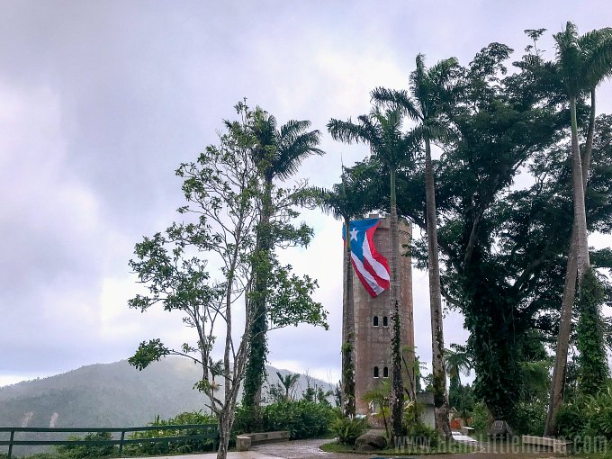 The Yokahu Tower draped with the Puerto Rican flag in El Yunque Rainforest.