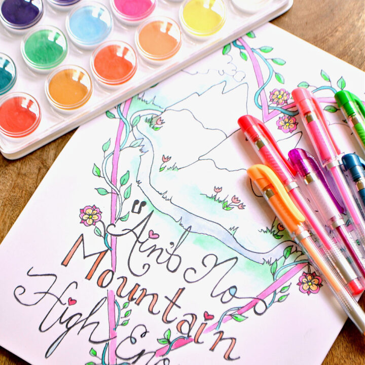 A coloring page topped with watercolors and gel pens.
