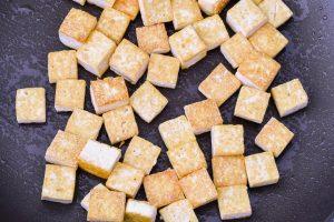 Fried tofu in a skillet.