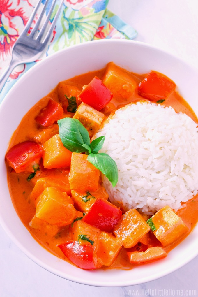 A creamy Pumpkin Curry made with tofu and coconut milk, served over rice.