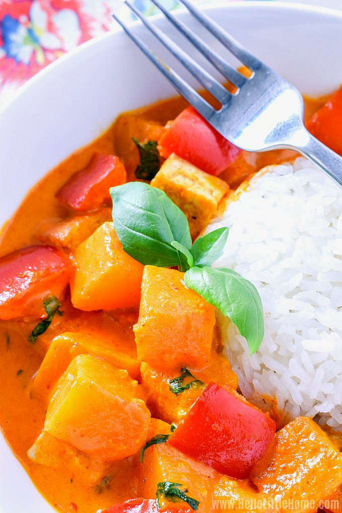 Closeup of a bowl of Red Coconut Curry with pumpkin and tofu.