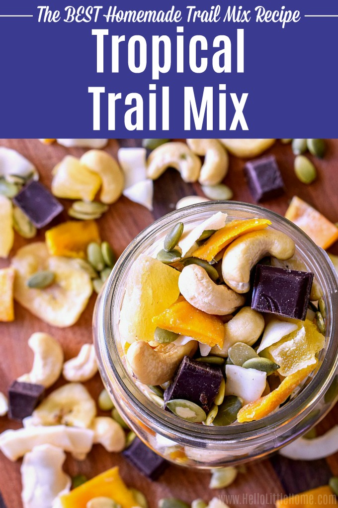 Easy Tropical Trail Mix recipe! Learn how to make homemade Trail Mix … it's so simple. This healthy trail mix is the perfect combo of sweet, salty, and savory flavors … nuts (cashews), pumpkin seeds, dried fruit (mango, pineapple, and banana), dark chocolate, and coconut chips. Make the recipe as is, or customize this vegan trail mix to your taste … it's such a yummy snack idea! | Hello Little Home #trailmix #snacks #snackrecipe #tropicaltrailmix #snackmix #vegan #glutenfree #healt...