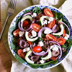 A bowl of Greek Quinoa Salad.