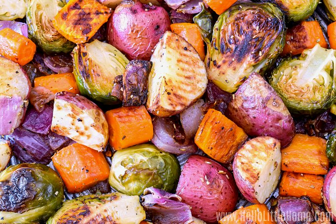 A photo of oven baked vegetables on a baking sheet.