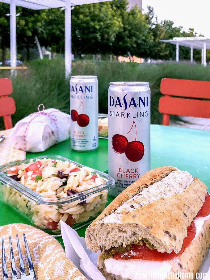 A picnic in Klyde Warren Park in Downtown Dallas with DASANI Sparkling, Orzo Pasta Salad, and a Caprese Sandwich.