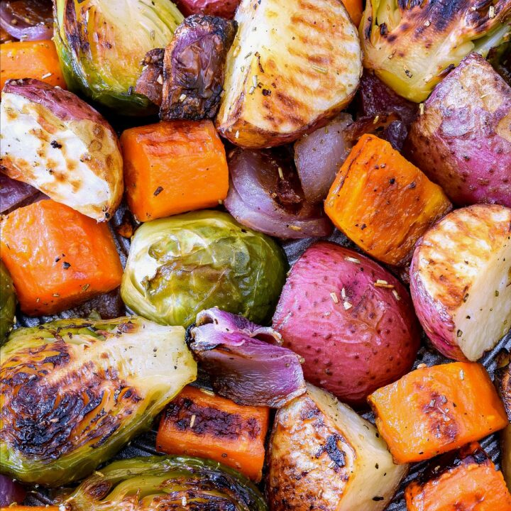 Roasted vegetables on a baking pan.