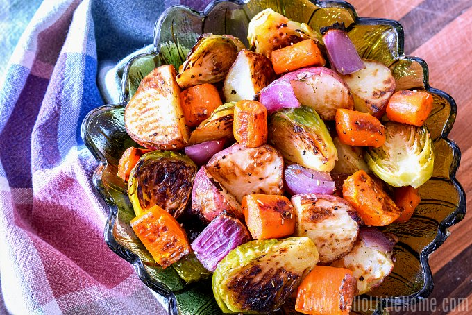A simple, healthy Roasted Vegetables served in a bowl with a plaid napkin.