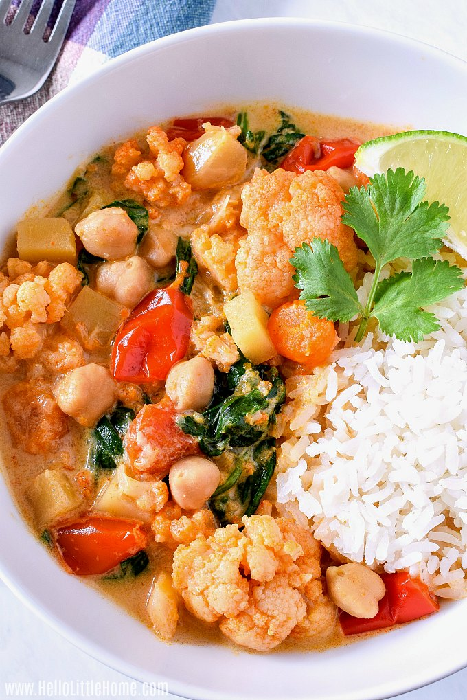 A bowl of the finished curry garnished with cilantro and lime.