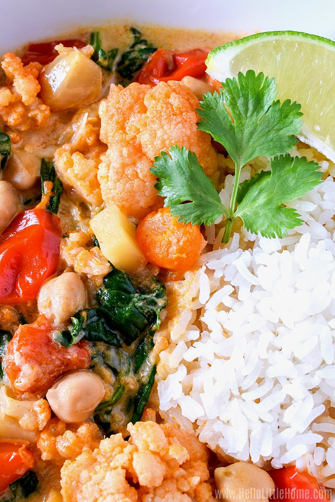 Closeup of a bowl of vegan Slow Cooker Veggie Curry served with rice.