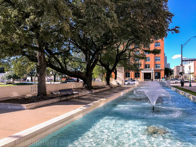 Exploring Dealey Plaza, one of the best things to do in Downtown Dallas.