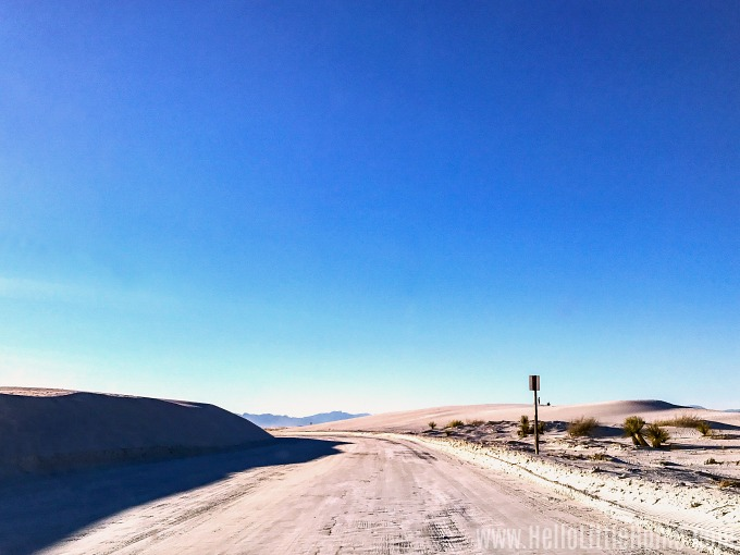 Driving along the empty Dunes Drive in White Sands National Monument.
