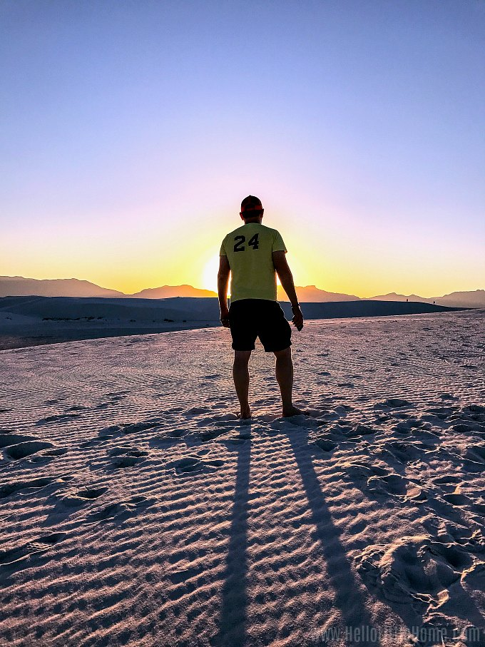 Sun setting with a person's silhouette during a White Sands National Monument sunset.