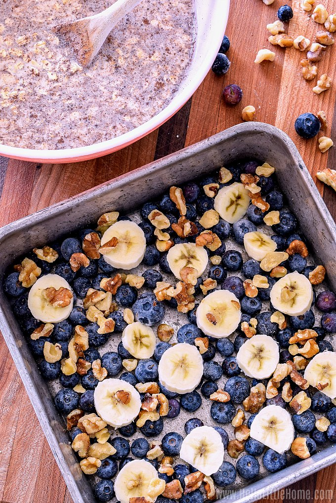 Adding blueberries, bananas, and nuts to the bottom of pan before adding other baked oatmeal ingredients.
