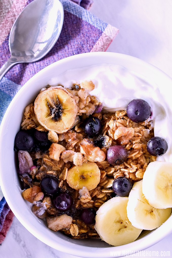 A bowl of healthy Baked Oatmeal served with yogurt and fresh fruit.