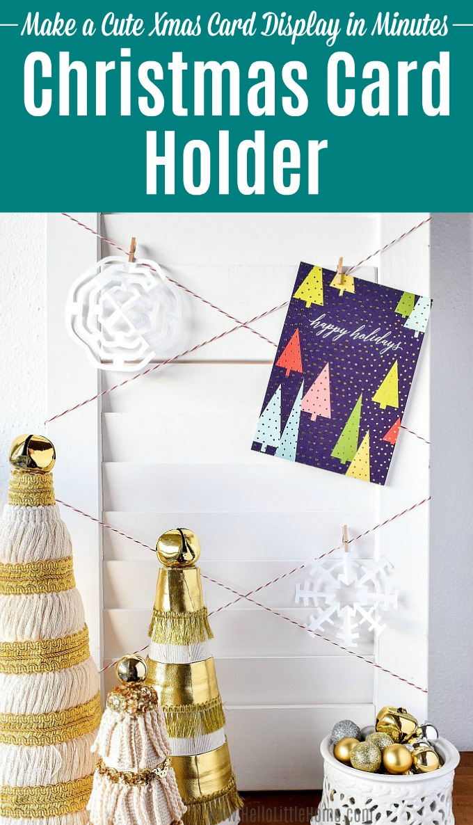 A DIY Christmas Card Holder covered with holiday cards and homemade snowflakes.