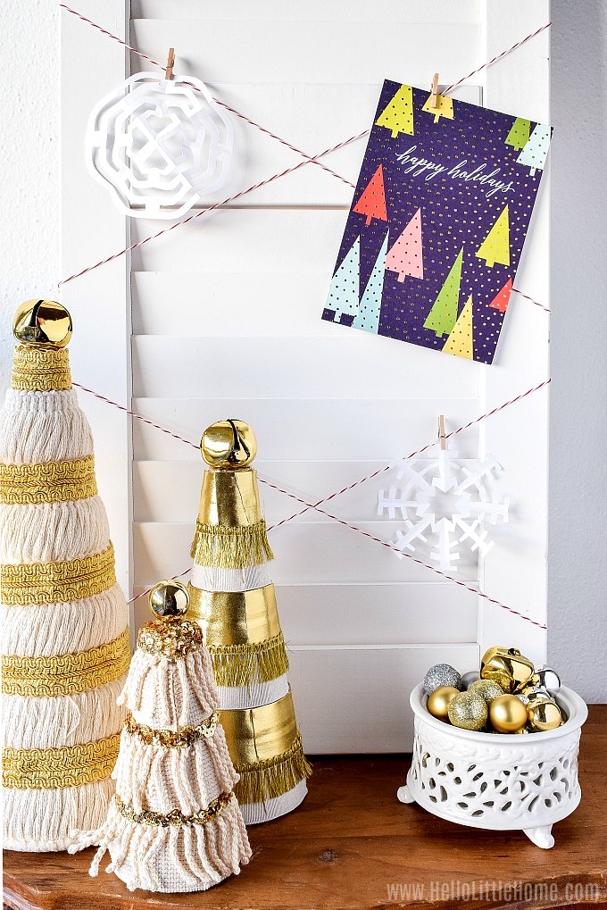 A DIY Holiday Card Holder decorated with snowflakes.