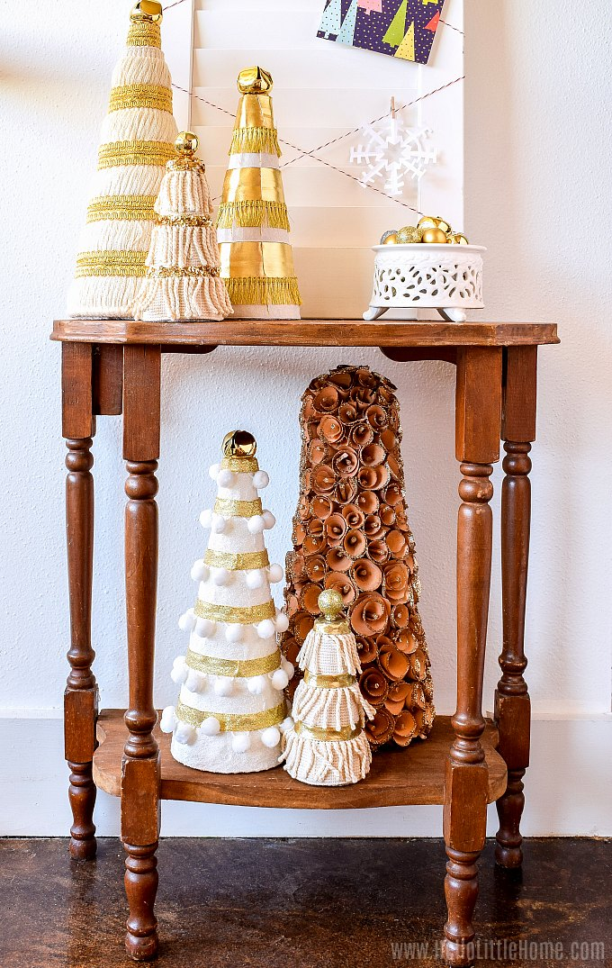 The card holder table decorated with handmade Christmas trees.