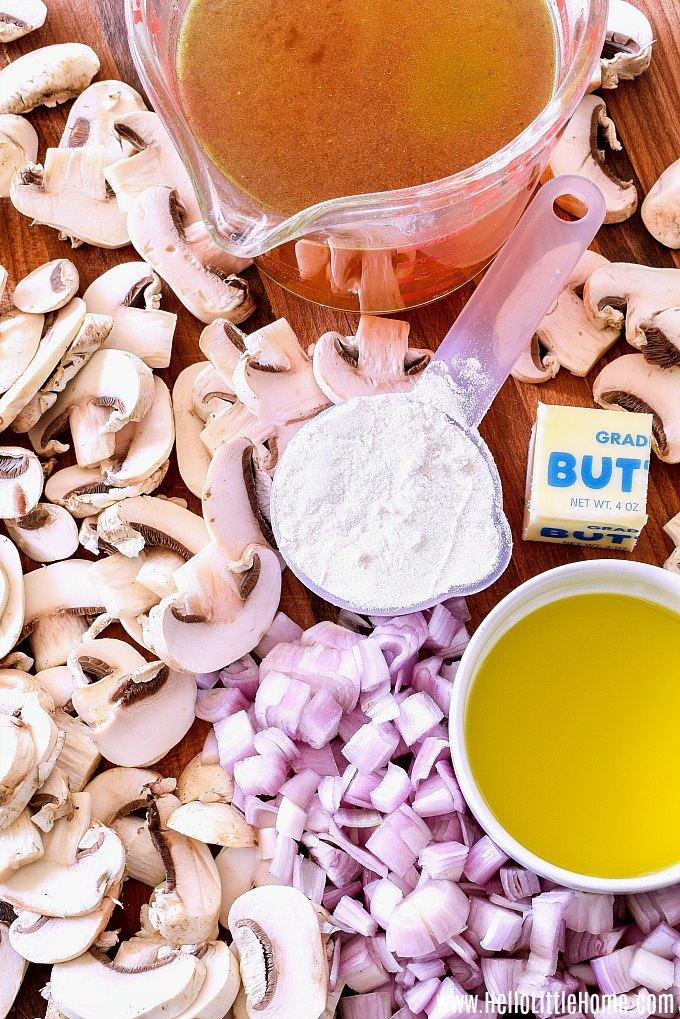 Vegetarian Mushroom Gravy ingredients: mushrooms, broth, flour, butter, shallots, and olive oil.