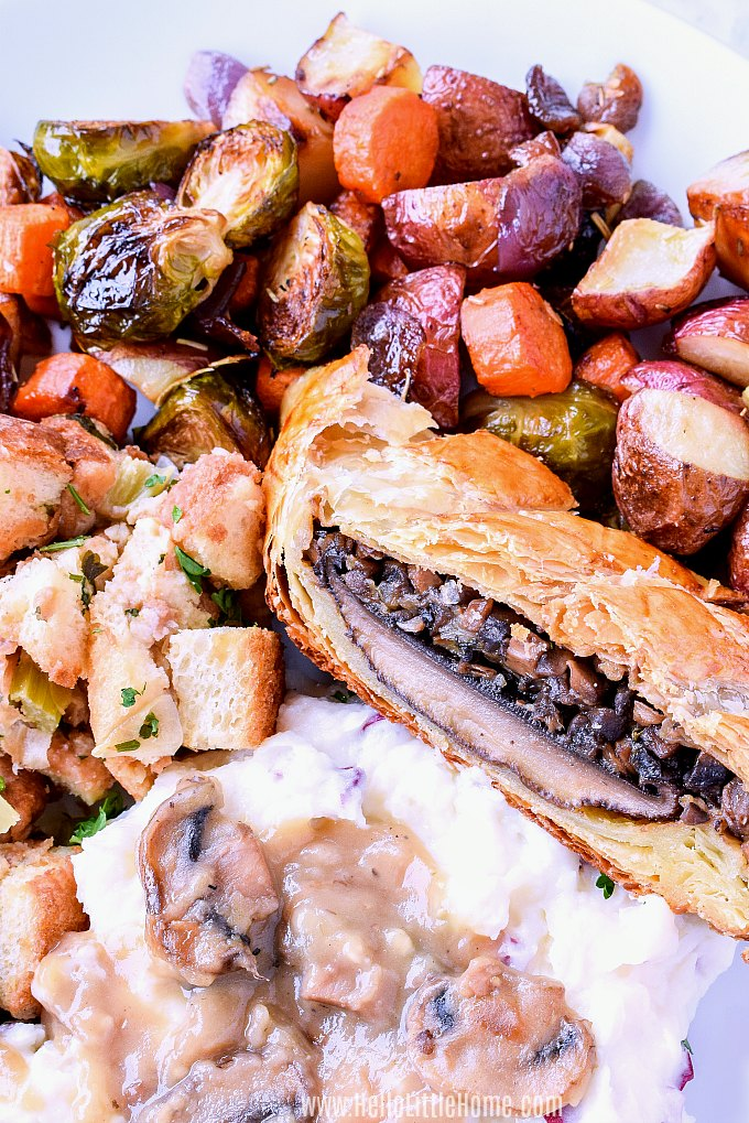 A Vegetarian Wellington recipe served with roasted vegetables, mashed potatoes, and stuffing.