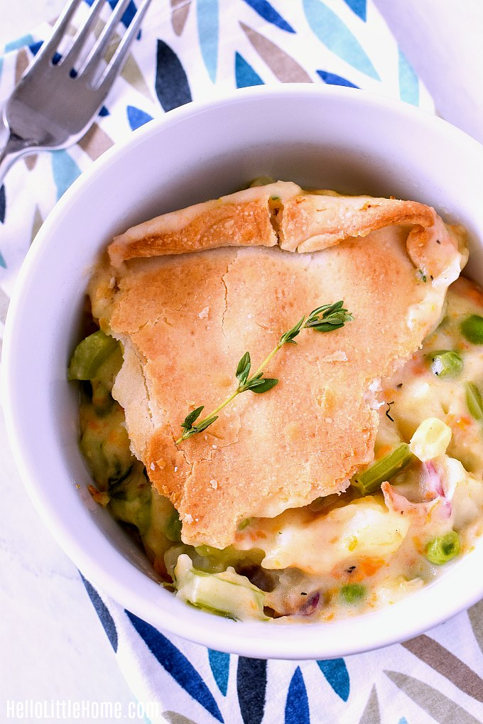 A colorful napkin topped with a bowl of Vegetable Pot Pie made in the Ninja Foodi.