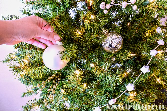 Adding balls to the Christmas tree.
