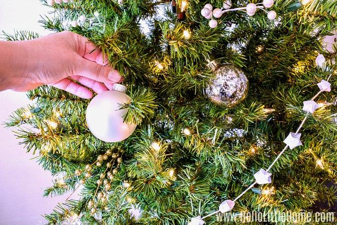 Adding balls to the Christmas tree.