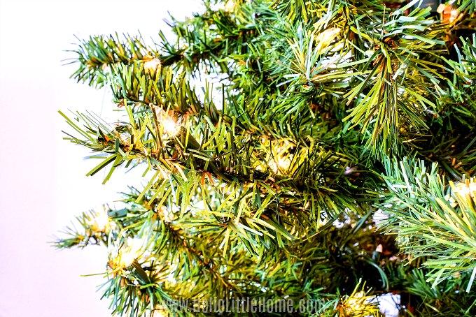Adding lights to the Christmas tree.