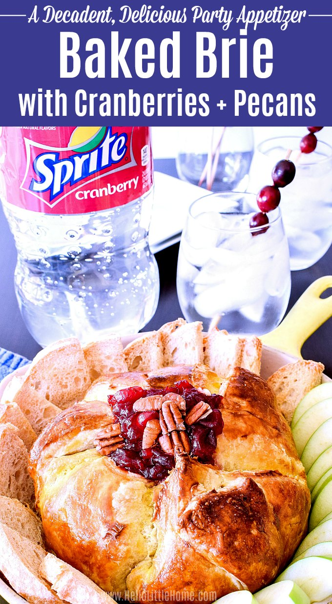Baked Brie with Cranberries and Pecans served in a skillet with crostini.