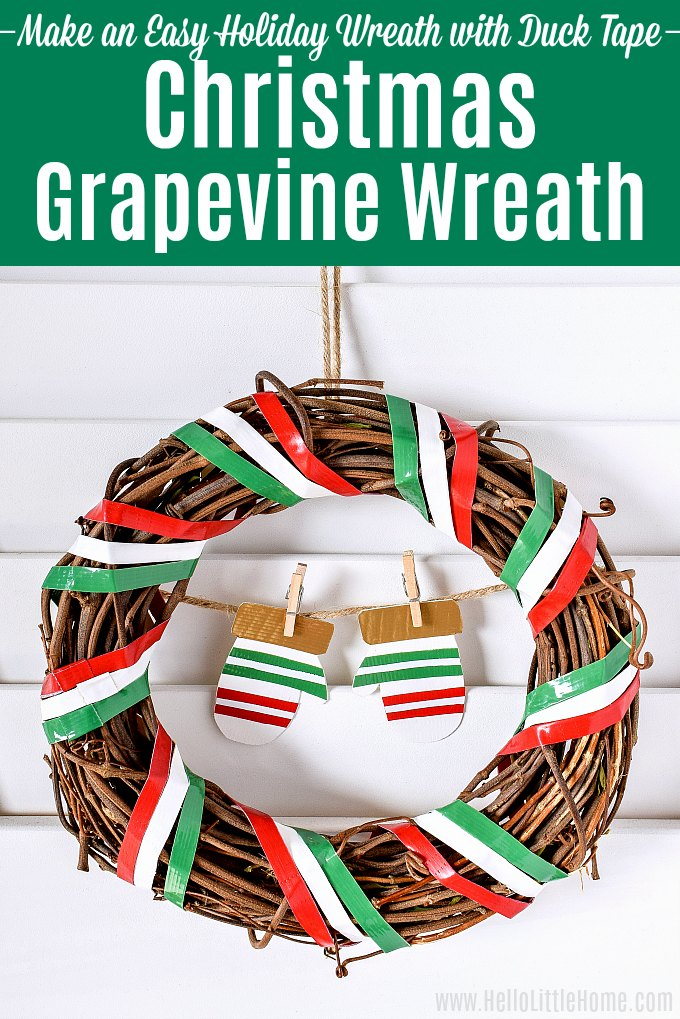 A Christmas Grapevine Wreath displayed on a white wood shutter.