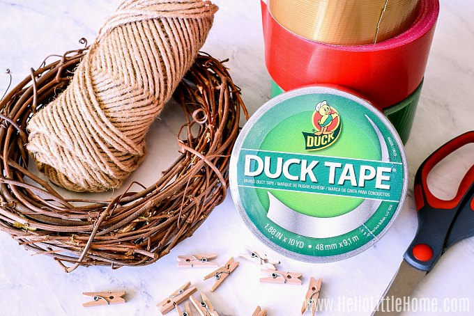 Christmas Grapevine Wreath Supplies: wreath, twine, Duck Tape, clothespins, scissors.