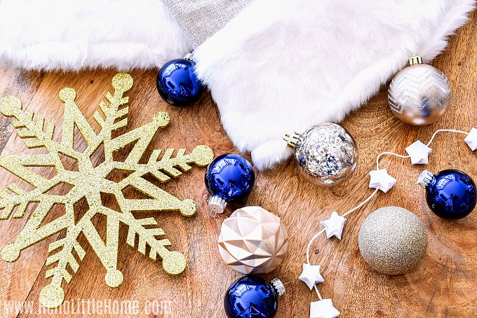 Choosing a Christmas tree theme with silver, gold, and blue elements.
