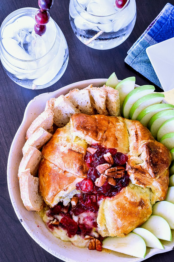An easy Cranberry Brie Appetizer served with crostini and apples.