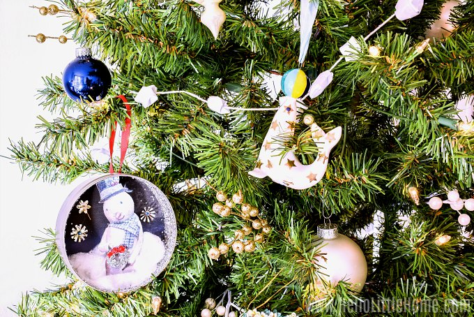 How to decorate a Christmas tree professionally: adding special ornaments.