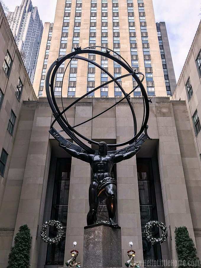 Checking out the Rockefeller Center's Atlas Statue during an NYC Christmas decorations walking tour.