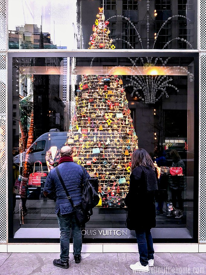NYC Christmas Windows: a beautiful tree in the window at Louis Vuitton.