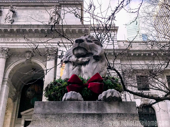 Best NYC Holiday Decorations: Wreath Decorated Lions at the New York Public Library.