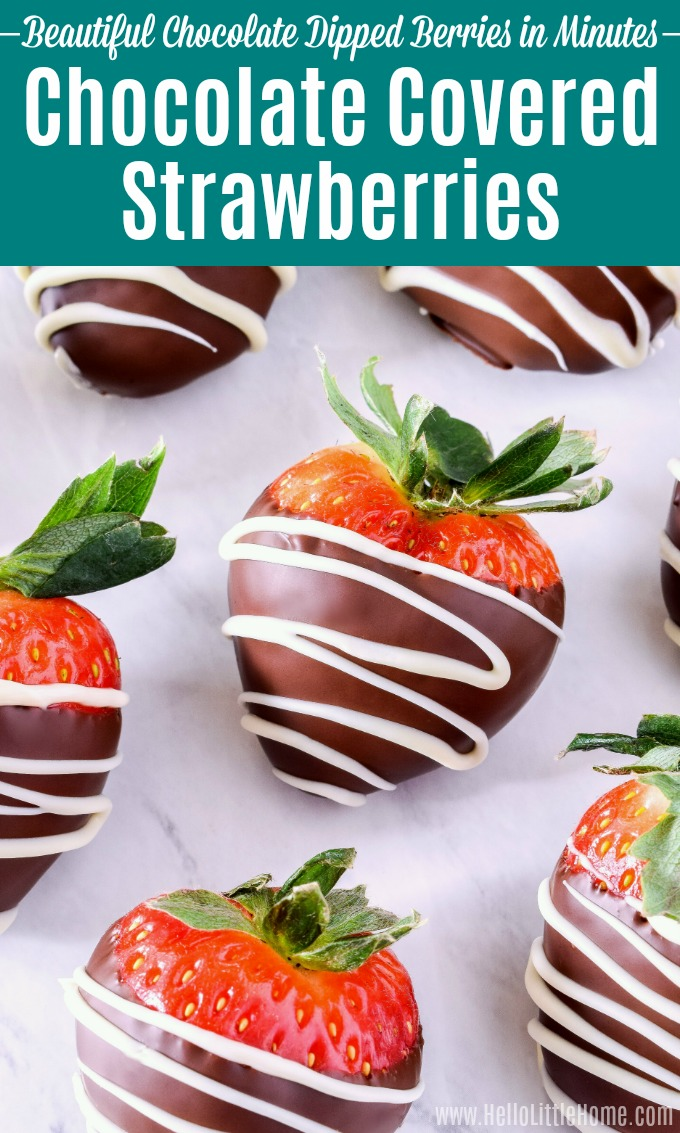 Chocolate covered strawberries drizzled with white chocolate on a marble counter.