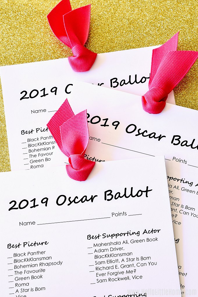 Printable Academy Awards Ballots for 2019 tied together with pink ribbon.