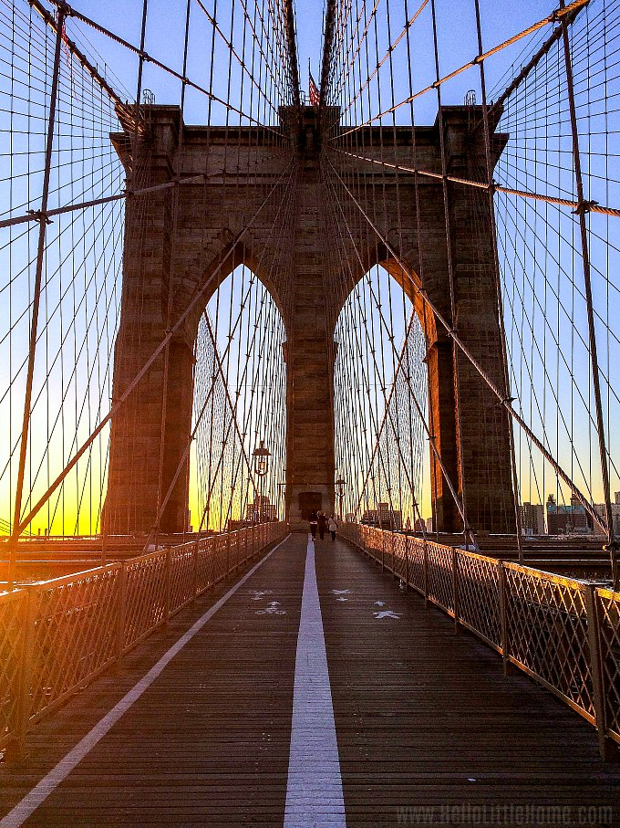 A sunrise view of the Brooklyn Bridge in New York.