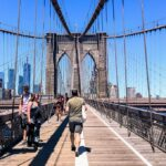 People walking the Brooklyn Bridge in New York.