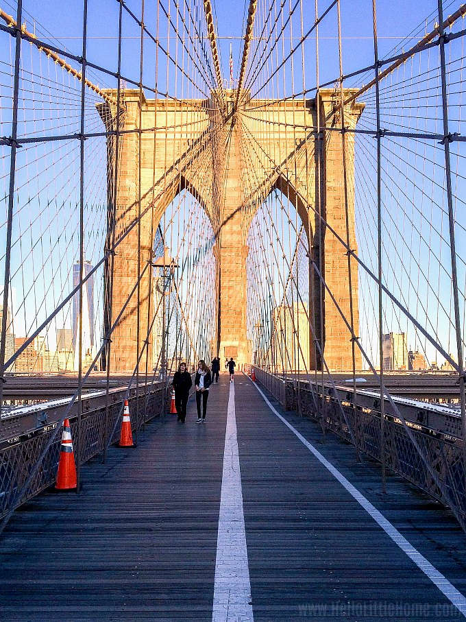 Walking the Brooklyn Bridge in New York in the morning.