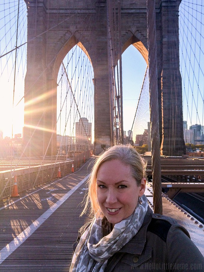 Taking a photo while walking the Brooklyn Bridge in New York.