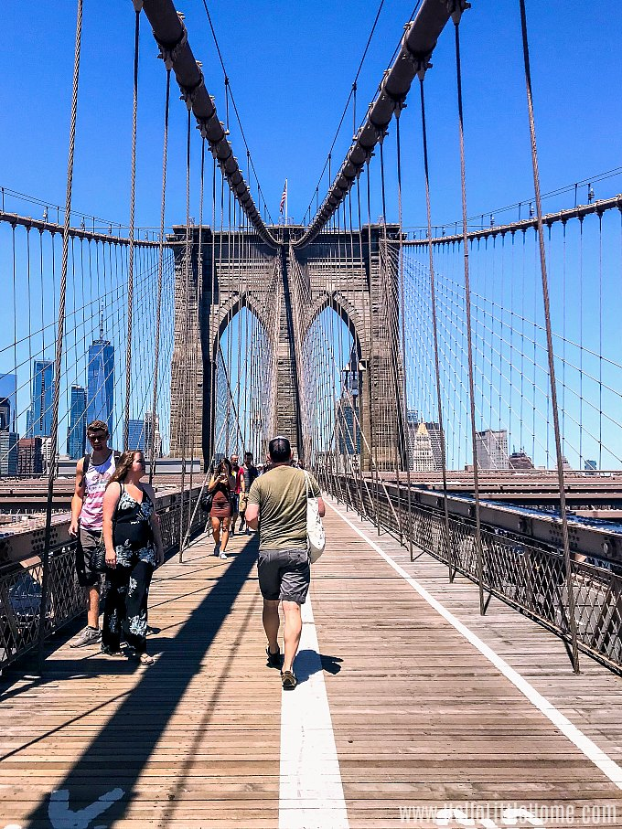 People walking the Brooklyn Bridge in New York.
