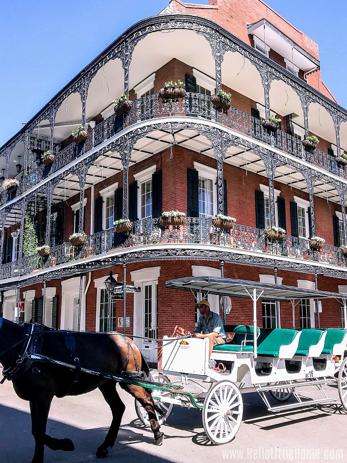 A three story building with cast iron balconies in the French Quarter.