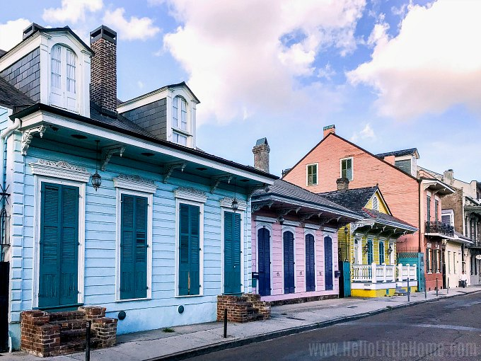 A colorful row of houses on a street in the French Quarter.
